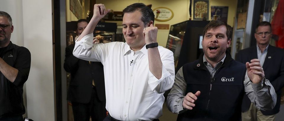 Cruz and Redden react to losing a game of foosball before a campaign event in Syracuse, New York