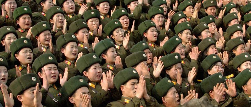 North Korean soldiers applaud during its leader Kim Jong-il's visit to the 324 military unit at the undisclosed place in North Korea