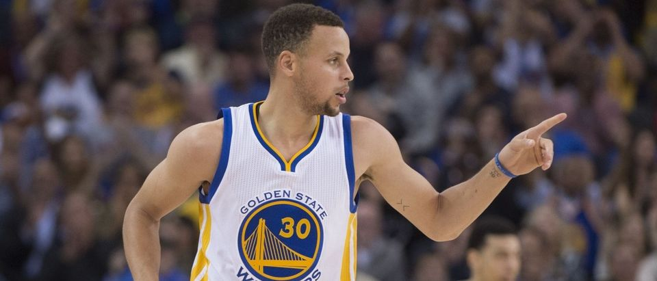 Golden State Warriors guard Stephen Curry celebrates after making a three-point basket during the second quarter against the San Antonio Spurs at Oracle Arena