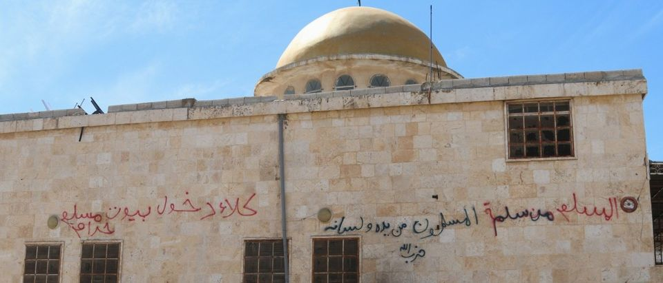 Graffiti is written on the exterior of a mosque in al-'Iss town after Syrian rebels and the al Qaeda-affiliated Nusra Front took control of the town, in Aleppo countryside