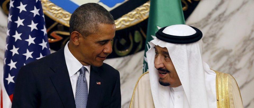 Saudi Arabia's King Salman speaks with U.S. President Barack Obama during the summit of the Gulf Cooperation Council (GCC) in Riyadh