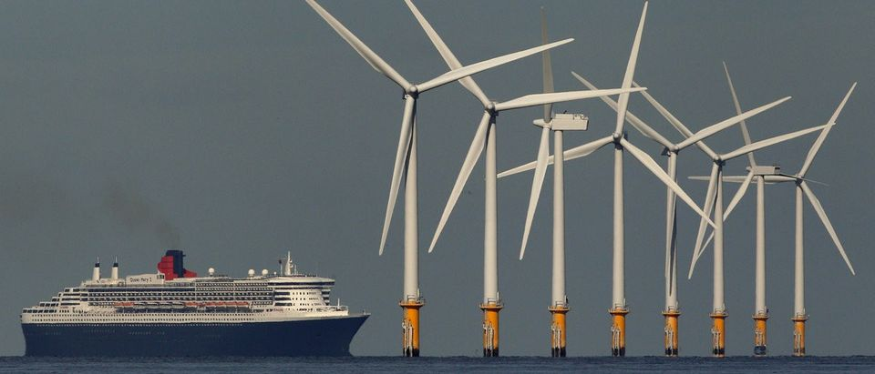 The cruise liner Queen Mary 2 passes the Burbo Bank off-shore wind farm as it heads to Liverpool