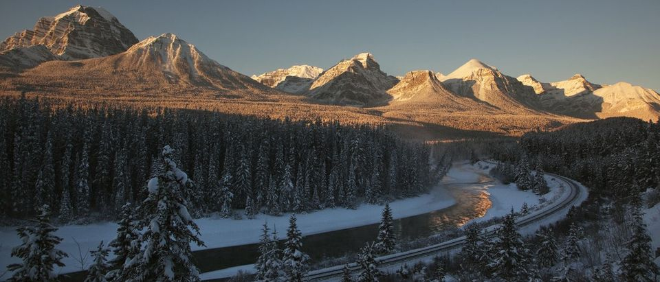 Mountain range is bathed in the morning sun in Lake Louise