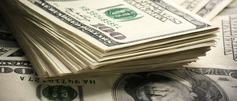 $100 dollar bills (Credit: Svetlana Lukienko/Shutterstock)