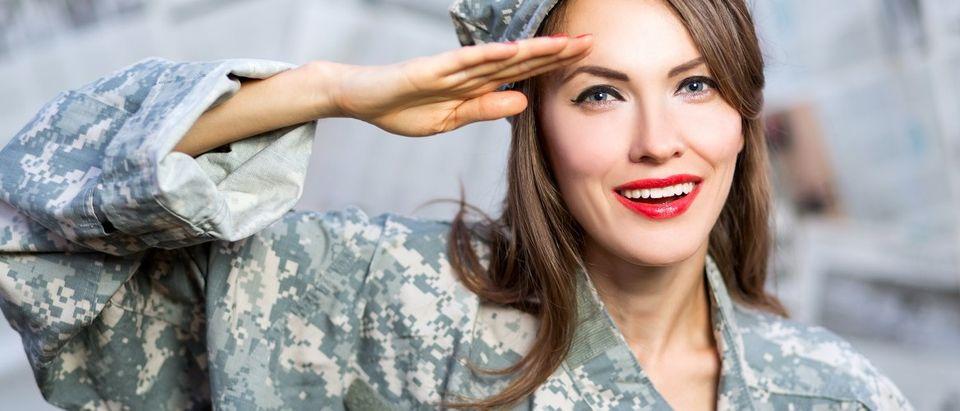 Brunette in military uniform (Shutterstock)