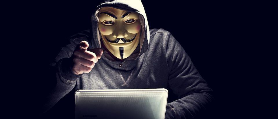 Portrait of a hacker in a mask.