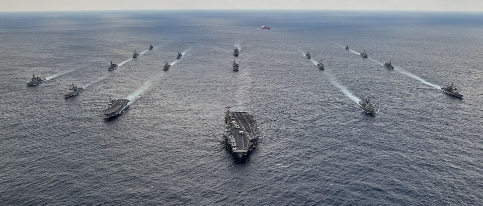 Handout photo shows U.S. Navy and Japan Maritime Self-Defense Force ships steaming in formation during their military manoeuvre exercise known as Keen Sword 15 in the sea south of Japan