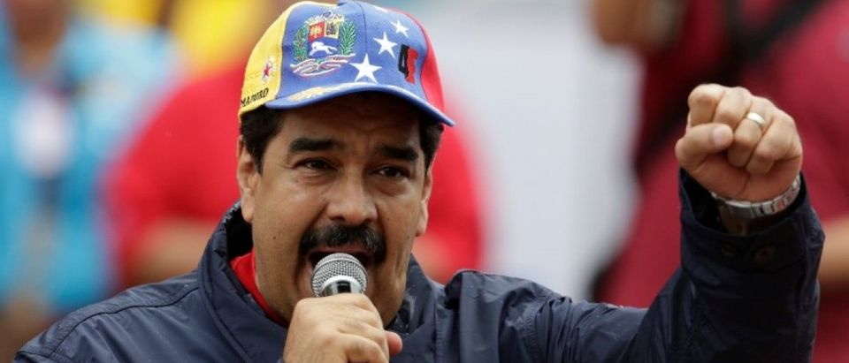 Venezuela's President Nicolas Maduro gestures as he talks to supporters during a rally to commemorate May Day, in Caracas