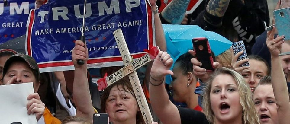 Supporters of U.S. Republican presidential candidate Donald Trump protest outside a campaign event for Democratic presidential candidate Hillary Clinton in Williamson