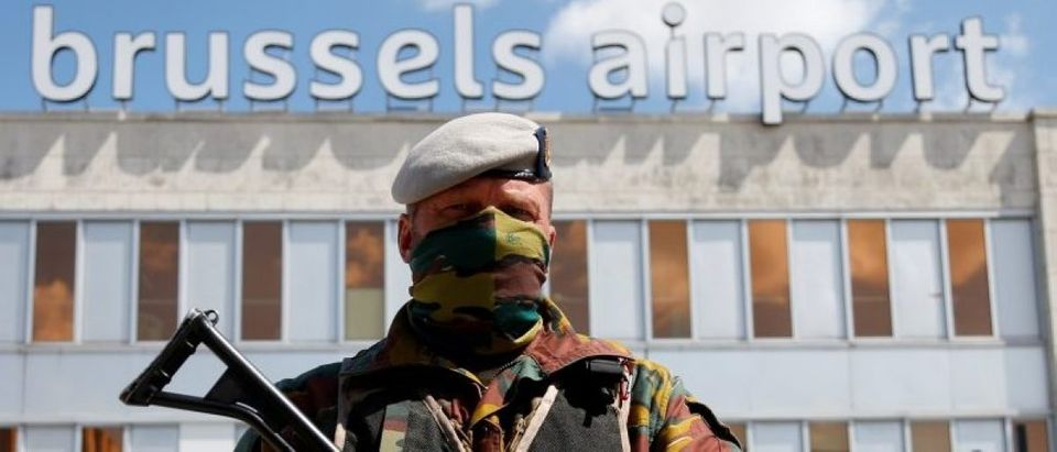 A Belgian soldier stands guard outside the partially reopened departure hall of Zaventem international airport near Brussels