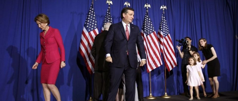 Republican presidential candidate Ted Cruz walks off the stage with his running-mate Carly Fiorina as his young daughters Caroline and Catherine (R) look on after he dropped out of the race for the Republican presidential nomination during his Indiana primary night rally in Indianapolis