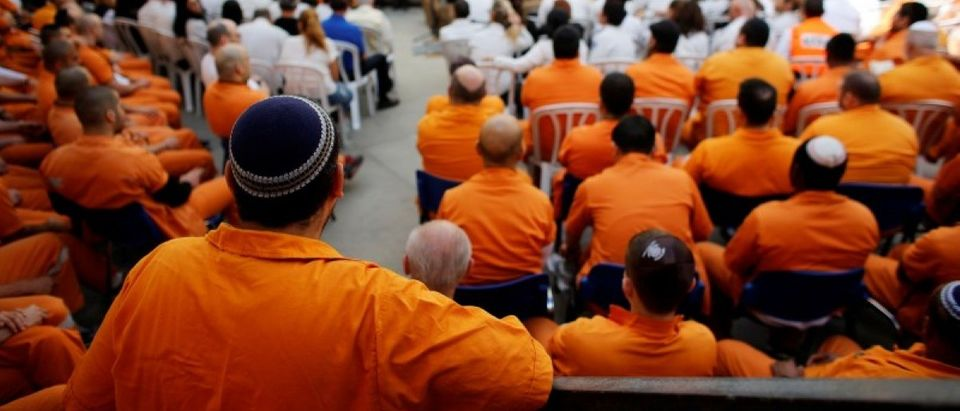 Prisoners take part in a ceremony marking the annual Holocaust Remembrance Day in Israel at Rimonim Prison, central Israel