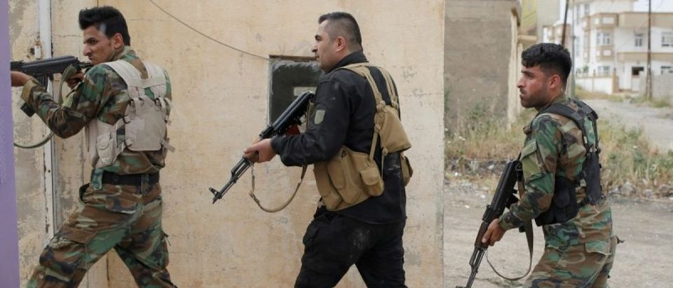 Kurdish Peshmerga fighters search for Islamic State militants in Tel Asqof