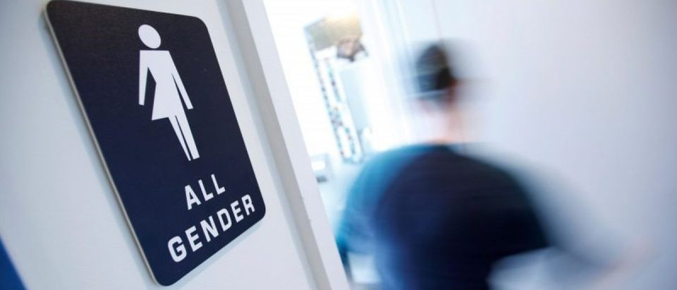 A bathroom sign welcomes both genders at the Cacao Cinnamon coffee shop in Durham, North Carolina May 3, 2016. REUTERS/Jonathan Drake/File Photo