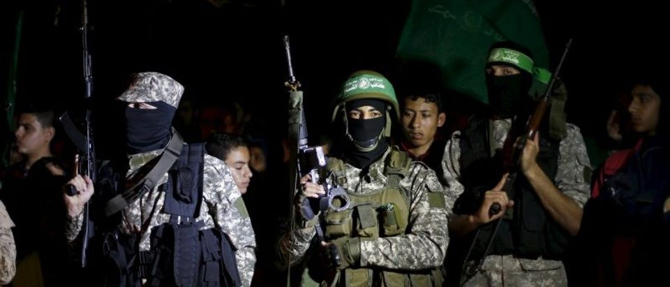Palestinian Hamas militants take part in a rally marking Palestinian Prisoners' Day, in Gaza City
