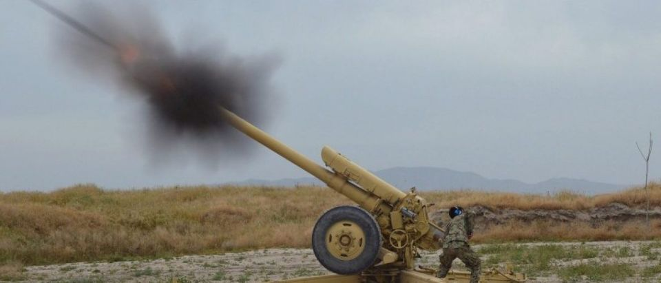Afghan National Army soldiers fire artillery during a battle with Taliban insurgents in Kunduz