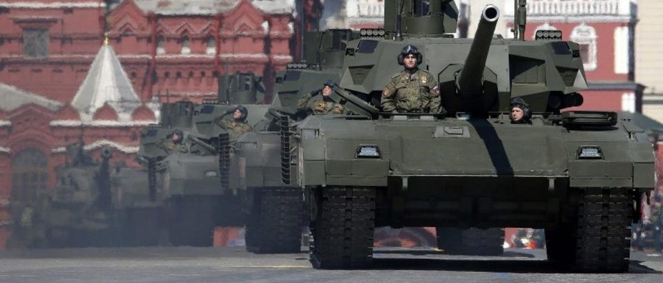 Russian servicemen stand atop T-14 tanks with the Armata Universal Combat Platform during the Victory Day parade, marking the 71st anniversary of the victory over Nazi Germany in World War Two, at Red Square in Moscow