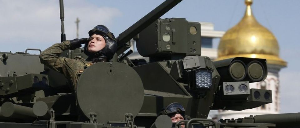 Russian servicemen drive Kurganets-25 armoured personnel carrier during Victory Day parade to mark end of World War Two at Red Square in Moscow