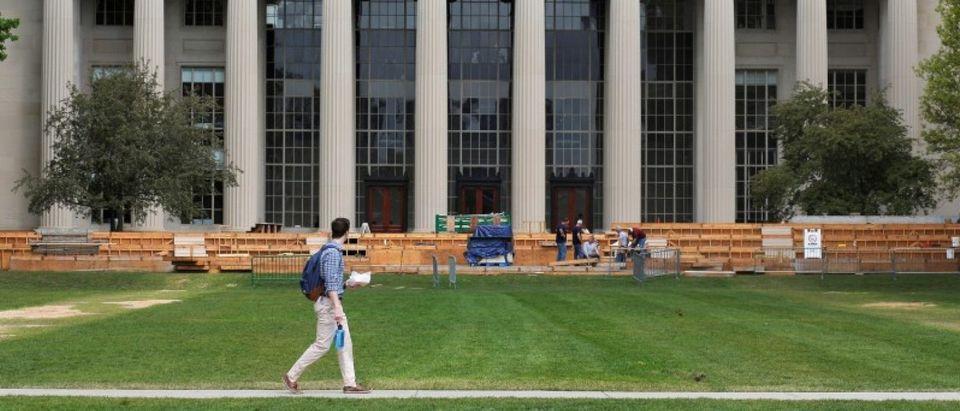 A man walks through Killian Court at MIT in Cambridge