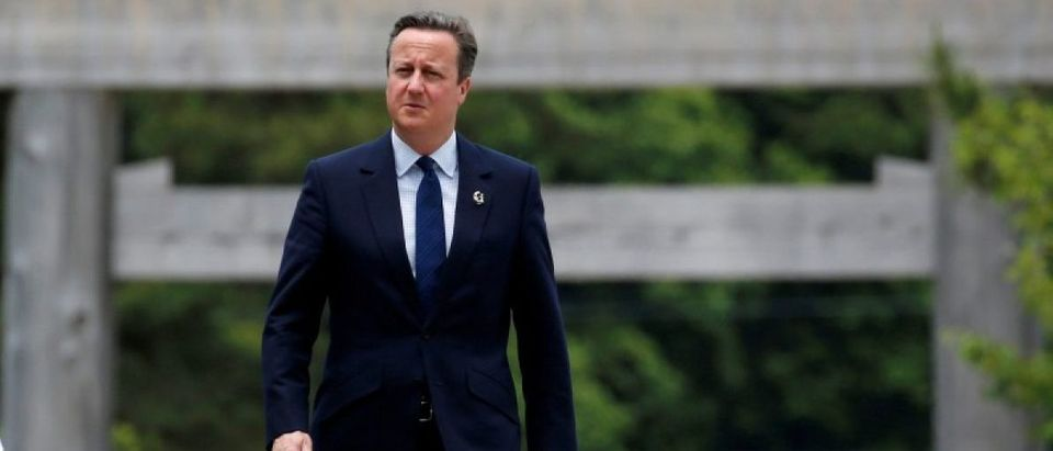 Britain's Prime Minister Cameron walks on Ujibashi bridge as he visits Ise Grand Shrine in Ise ahead of the first session of the G7 summit meetings.