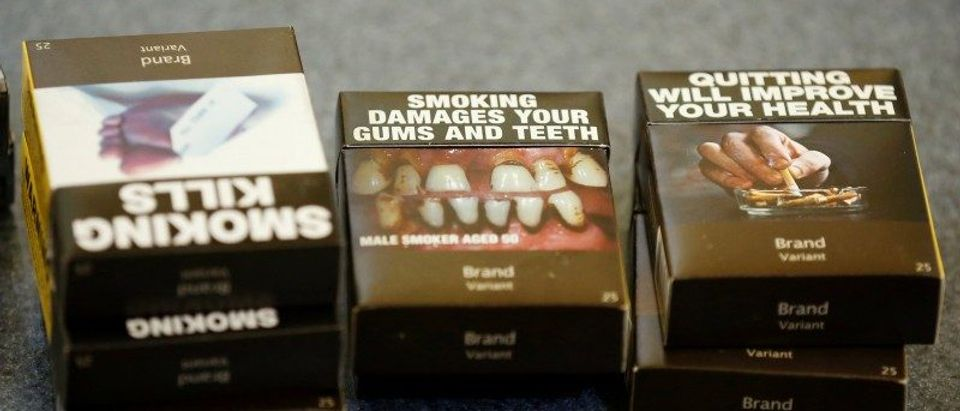 Mock-ups of plain cigarette packaging are seen before the start of a news conference in Ottawa