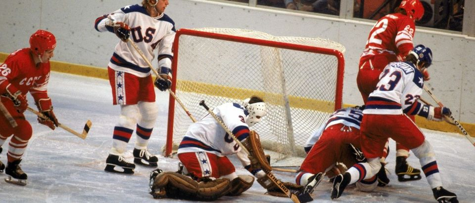 Goalie Jim Craig #30 and his teammate Mike Ramsey #5 of the United States protect the goal during the Olympic hockey game against the Soviet Union on February 22, 1980 in Lake Placid, New York
