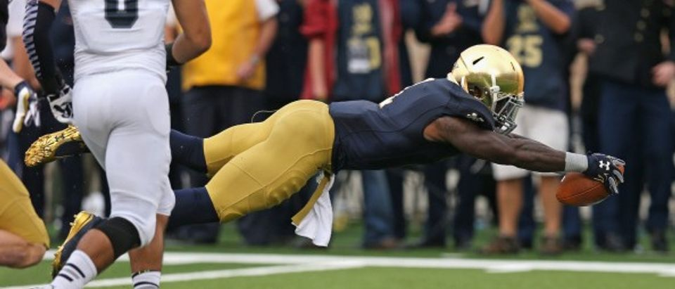 Greg Bryant of the Notre Dame Fighting Irish dives into the end zone for a touchdown