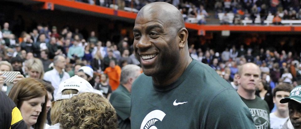 Michigan State Spartans former player Magic Johnson during the second half against the Oklahoma Sooners in the semifinals of the east regional of the 2015 NCAA Tournament at Carrier Dome