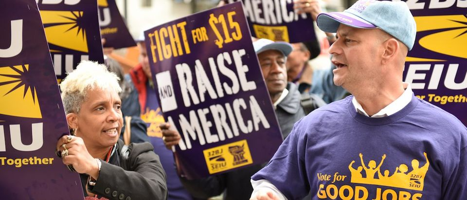 union & labor activists gathered along Varick Street to urge the NY Wage Board on its first ever meeting to seek a $15 per hour minimum wage. (Shutter stock).
