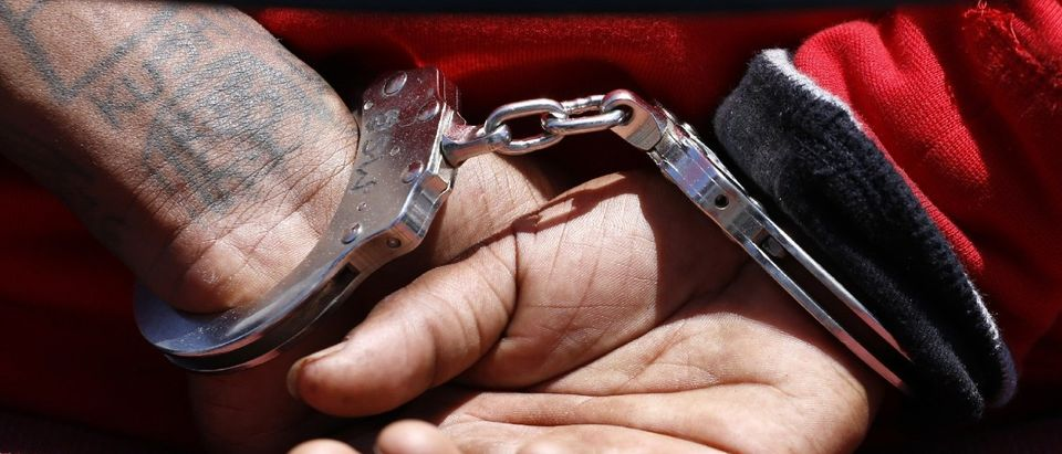 Here are the handcuffs of a suspected member of the Broadway Gangster Crips street gang. (REUTERS/Jonathan Alcorn)