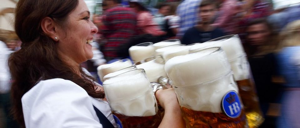 A waitress carries beer during the first day of the 182nd Oktoberfest in Munich