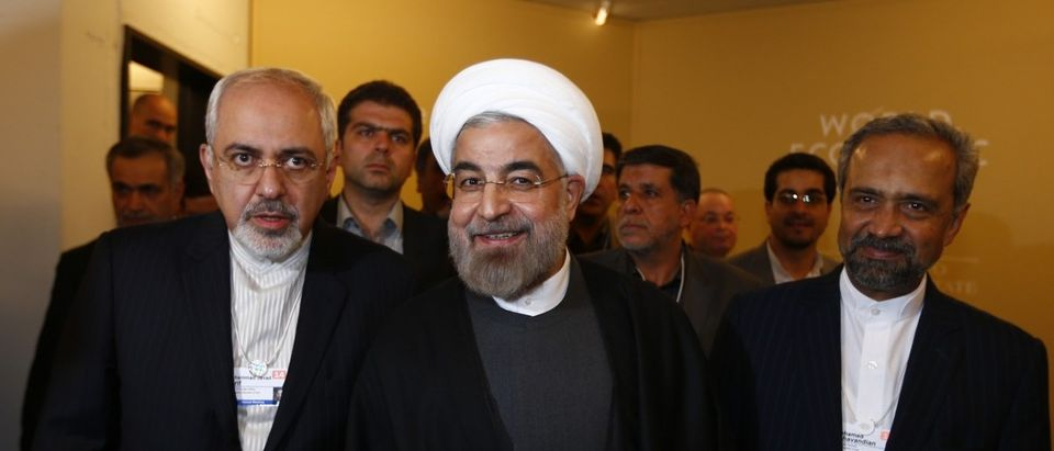 Iran's President Rouhani Foreign Minister Mohammad Zarif and Nahavandian the Head of Iran Presidential Office arrive for meeting at World Economic Forum in Davos