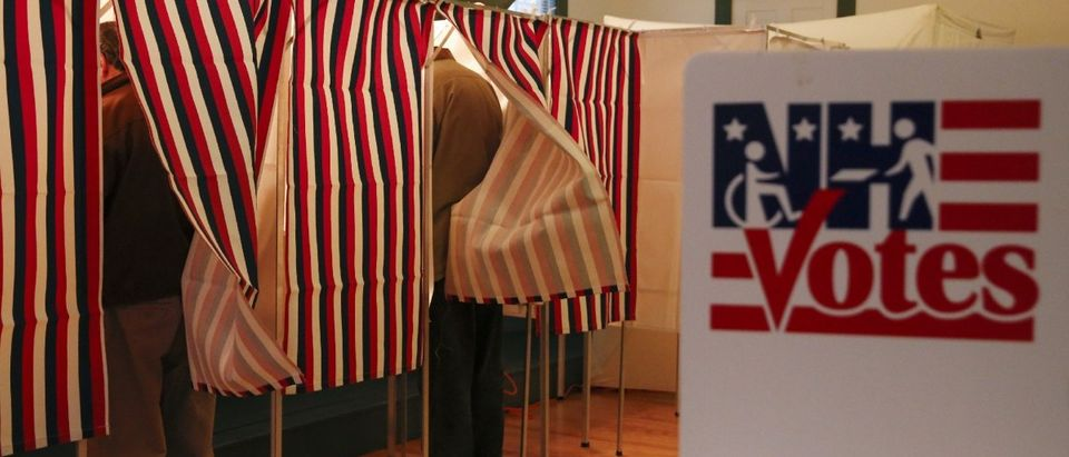 People vote at a polling place at the Canterbury Town Hall polling station (REUTERS/Shannon Stapleton)