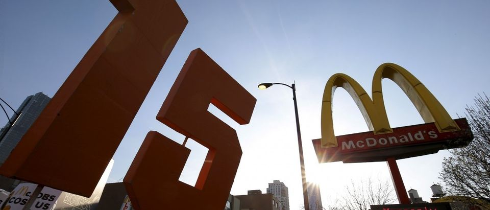 Demonstrators march past a McDonald's restaurant during a protest calling for a $15-an-hour nationwide minimum wage in downtown Chicago