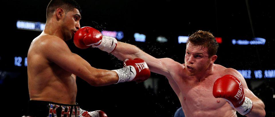 Canelo Alvarez knocks out Amir Khan (Reuters Pictures)