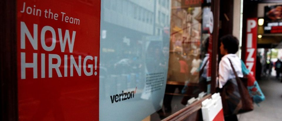 "A ""Now Hiring"" sign is posted on a Verizon store in Manhattan in New York"