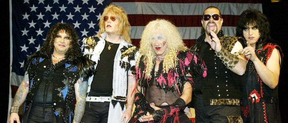 Members of the reunited metal band Twisted Sister, A.J. Pero (L), J.J. French (2nd L), Dee Snider (C..