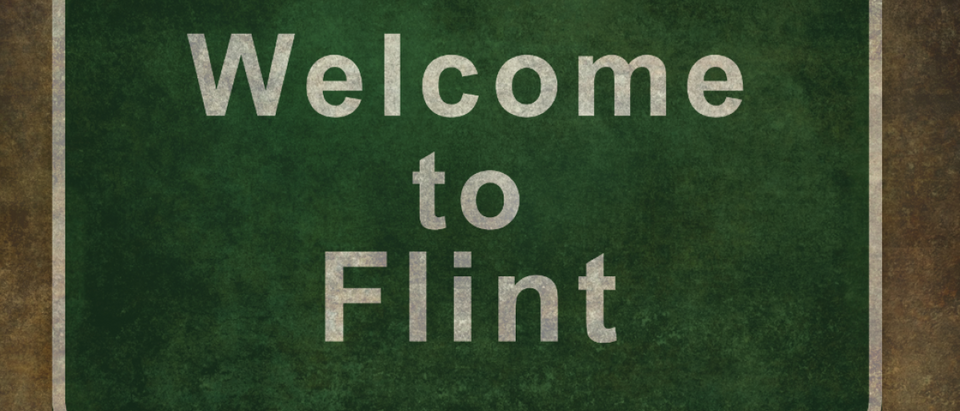 Welcome to Michigan road sign illustration, with distressed Ominous background (Copyright: Shutterstock/Bruce Stanfield)