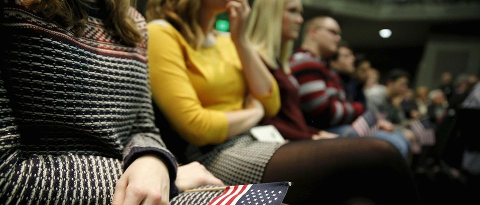 Students listen as Ben Carson speaks at a Trust in God town hall at Simpson College in Indianola, Iowa, January 25, 2016