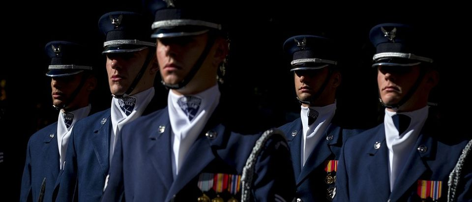 Members of the U.S. Air Force Honor Guard stand at attention at the 9/11 Memorial in New York
