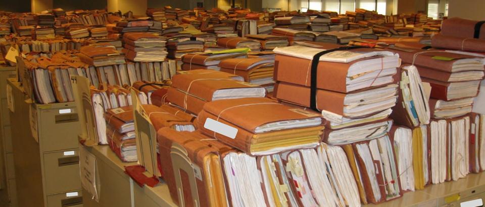 Stacks of paper records at a VA facility