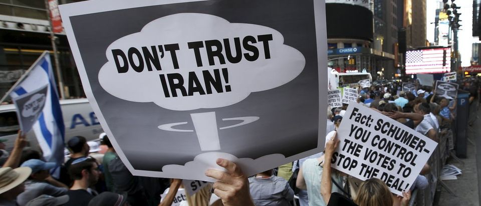 A man holds up a sign as he and several thousand other protestors demonstrate during a rally apposing the nuclear deal with Iran in Times Square in the Manhattan borough of New York