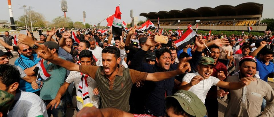 Followers of Iraq's Shi'ite cleric Moqtada al-Sadr shout slogans at Grand Festivities Square within the Green Zone in Baghdad