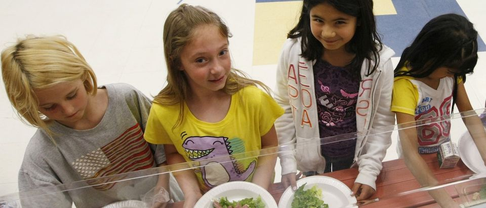 Students at Rose Hill Elementary School choose the salad bar for lunch in Commerce City, Colorado May 1, 2012 instead of hamburgers and potatoes that were offered this day