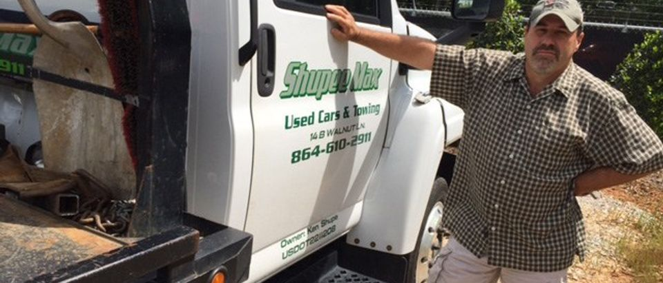 Ken Shupe stands next to his tow truck (Facebook/Shupee Max Towing)