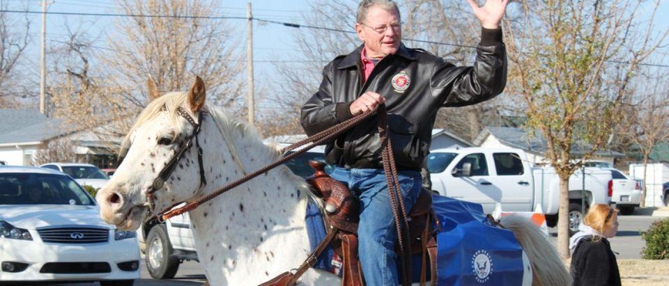 BROKEN ARROW, OK-DECEMBER 4: Oklahoma Senator Jim Inhofe (R) rides in Christmas Parade in Broken Arrow, Tulsa's suburb, on December 4, 2010. Inhofe chose not ride in Tulsa's Holiday Parade of Lights. Credit: val lawless / Shutterstock.com