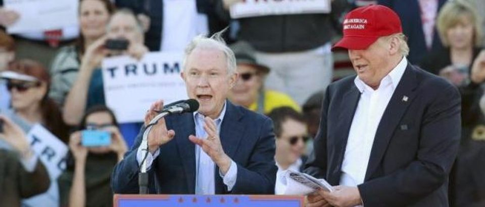 U.S. Senator Jeff Sessions speaks next to U.S. Republican presidential candidate Donald Trump at a rally at Madison City Schools Stadium in Madison