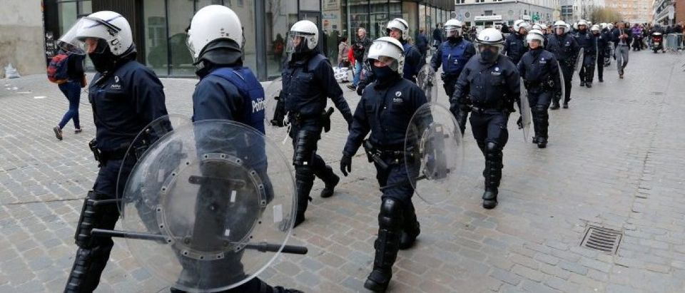 Belgian police march as they take position in the Brussels district of Molenbeek