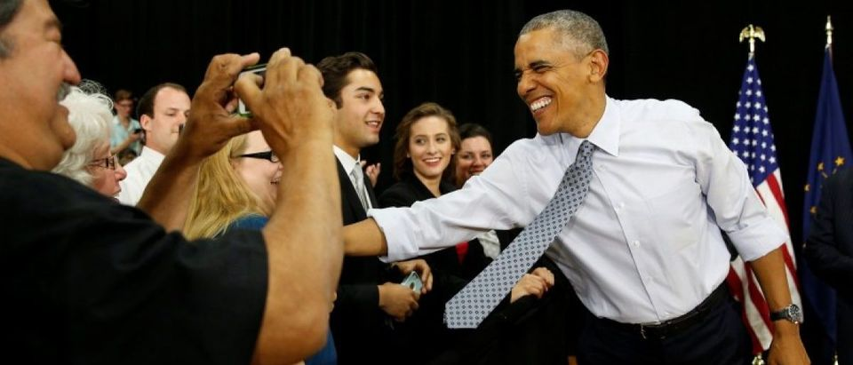 U.S. President Barack Obama shakes hands as he arrives to speak about the economy during a visit.