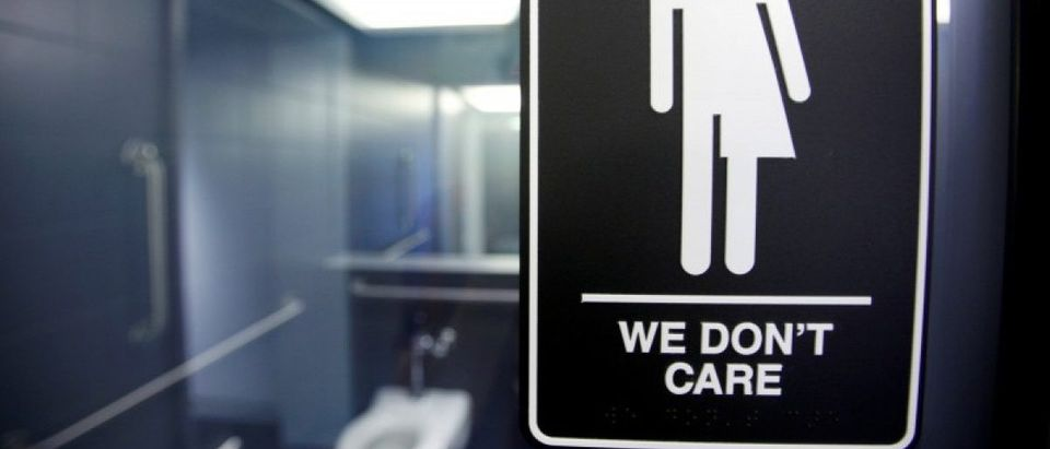 A sign protesting a recent North Carolina law restricting transgender bathroom access is seen in the bathroom stalls at the 21C Museum Hotel in Durham, North Carolina May 3, 2016. REUTERS/Jonathan Drake